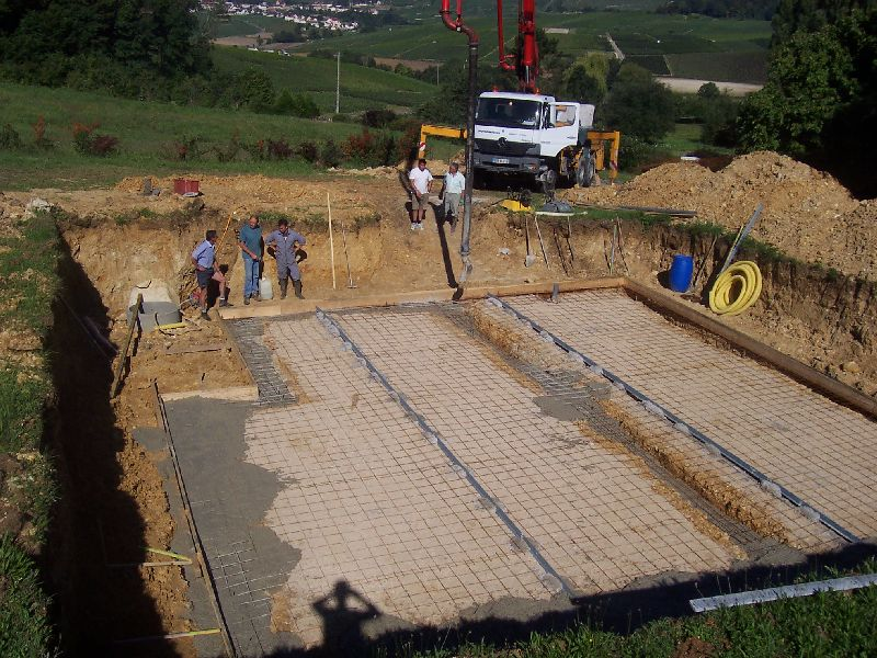 B ton auto construction d 39 une maison en bois massif for Couler dalle beton garage