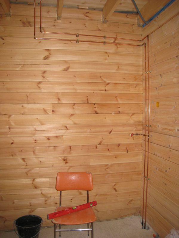 plomberie auto construction d 39 une maison en bois massif. Black Bedroom Furniture Sets. Home Design Ideas